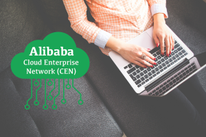 Alibaba CEN logo with woman using laptop